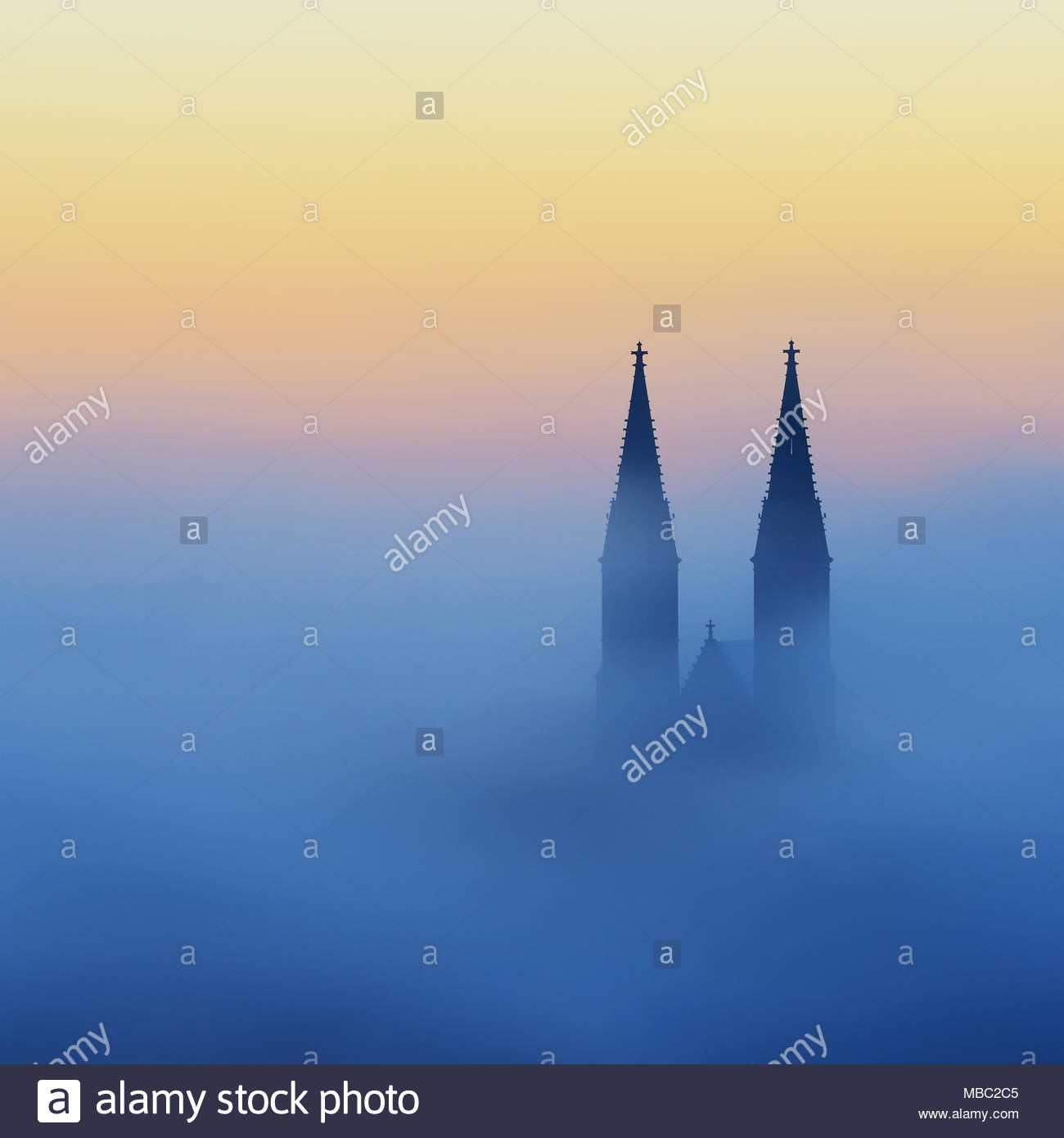 Foggy autumn morning. Detail of Vysehrad church. Fog wave in the historical city. Sunny morning in Prague, Czech republic - Stock Image