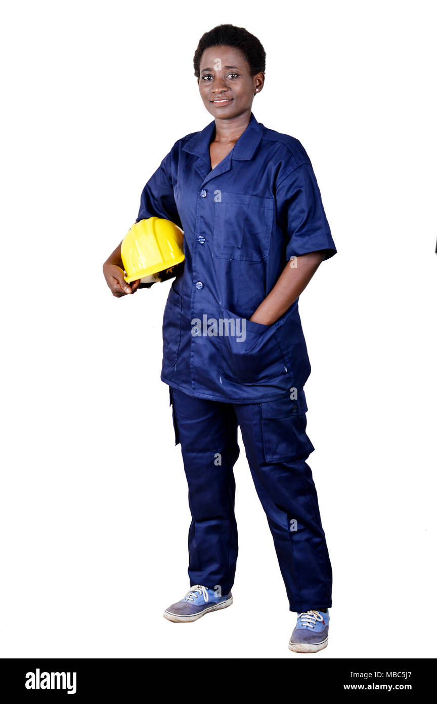 Young smiling construction worker holding his helmet on a white background - Stock Image