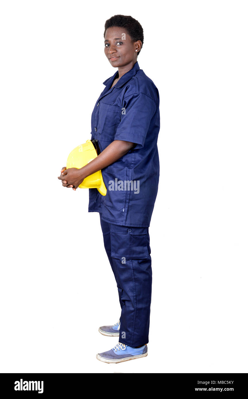 Young construction worker holding his helmet on a white background. - Stock Image