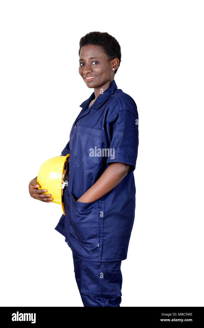 Young smiling construction worker holding his helmet on a white background. - Stock Image