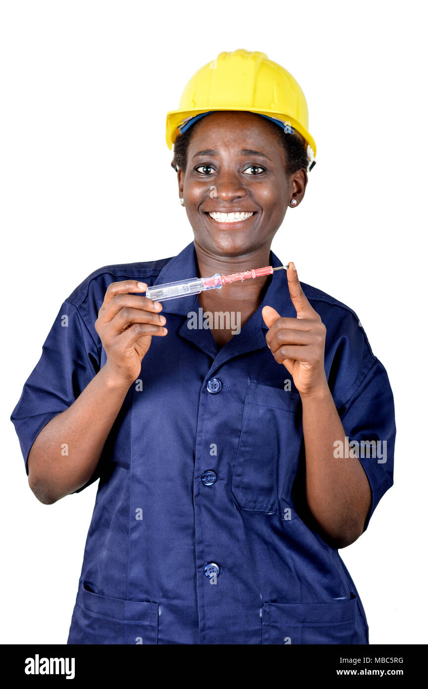 Smiling young woman showing her work tool. - Stock Image