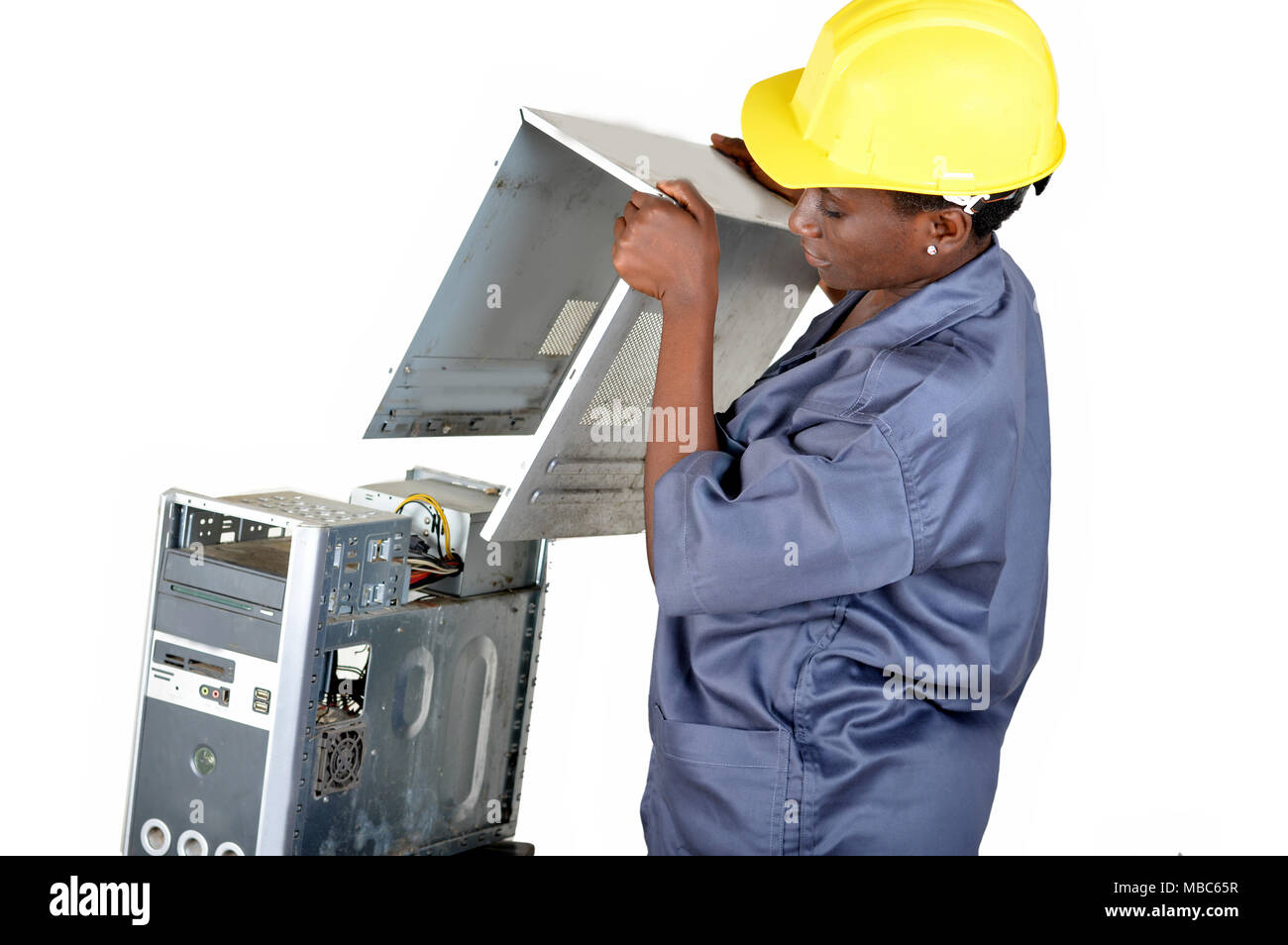Young computer maintenance technician opens a desktop computer to locate the breakdown - Stock Image