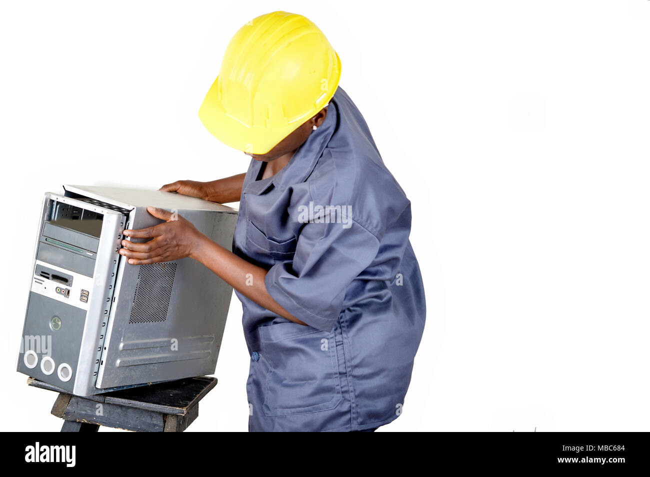 Young computer maintenance technician opens a desktop computer to locate the breakdown. - Stock Image