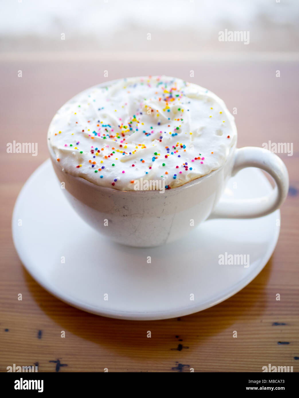 A birthday cake latté from D'lish by Tish Cafe in Saskatoon, Saskatchewan, Canada. - Stock Image