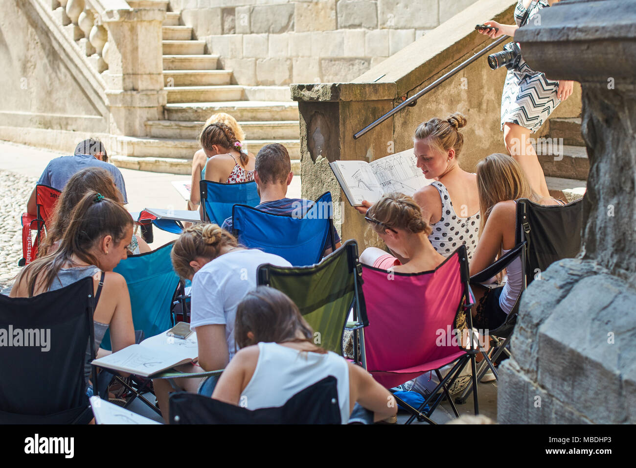 Architecture students drawing architectural details during en plein air assignment near Basilica of Santa Maria Maggiore in historical Upper Town - Stock Image