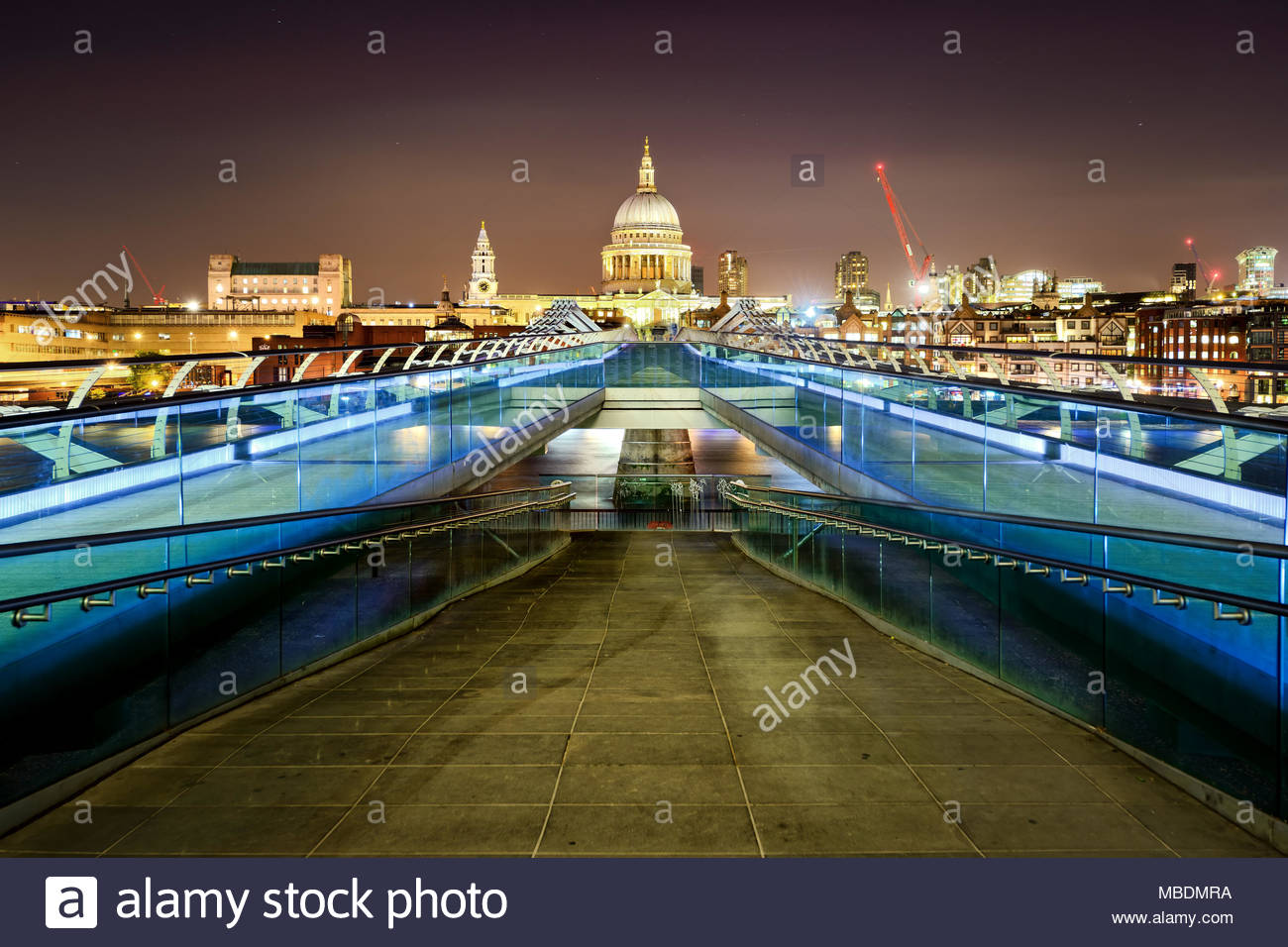 St Paul's Cathedral during night from the Millennium bridge over river Thames, London, United Kingdom. - Stock Image
