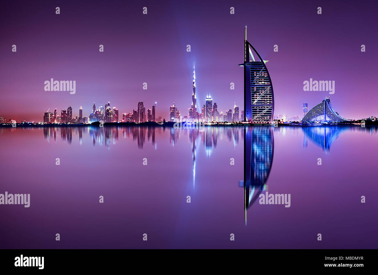 Detail of skyscraper reflection. Beautiful skyline scene in Dubai. Multiple highest buildings during night. The Palm island, United Arab Emirates. - Stock Image