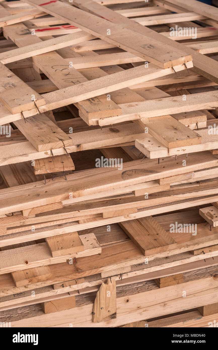 Pile of wooden slats from industrial pallets which have been broken up. - Stock Image
