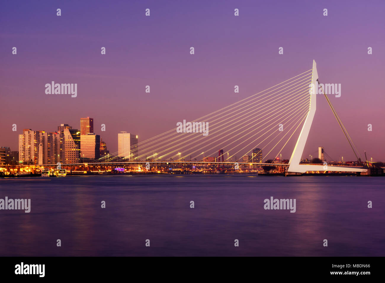 Amazing sunset view of Erasmus bridge and several skyscrapers in Rotterdam, Holland. Fascinating modern architecture. - Stock Image