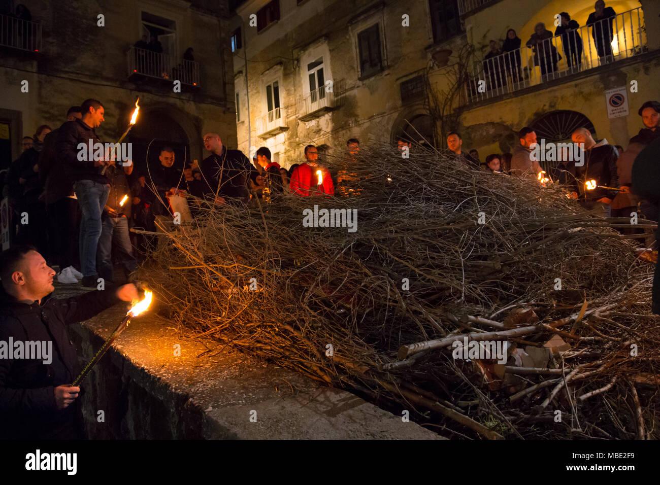 SESSA AURUNCA, ITALY - MARCH 30, 2018 - On Easter Good Friday, at sunset, during the parade of black hoods, men light bonfires on street corners - Stock Image