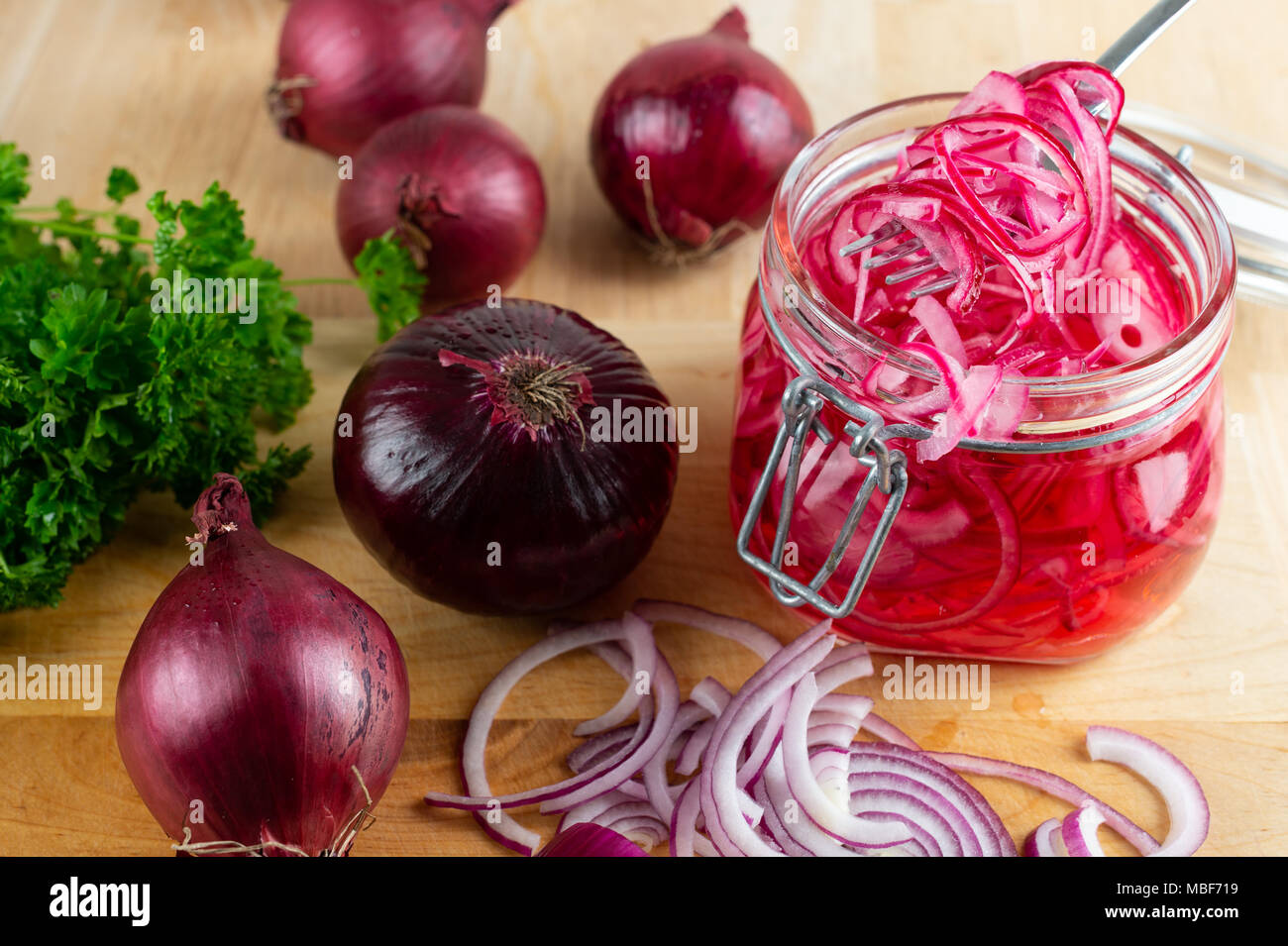 Homemade pickled sliced red onion. - Stock Image