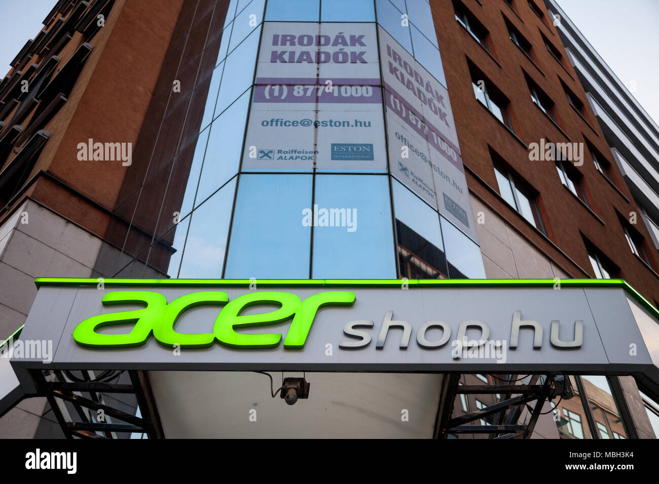 BUDAPEST, HUNGARY - APRIL 6, 2018: Acer logo on their main shop for Hungary during the evening. Acer is one of the main Computer manufacturers in the  - Stock Image