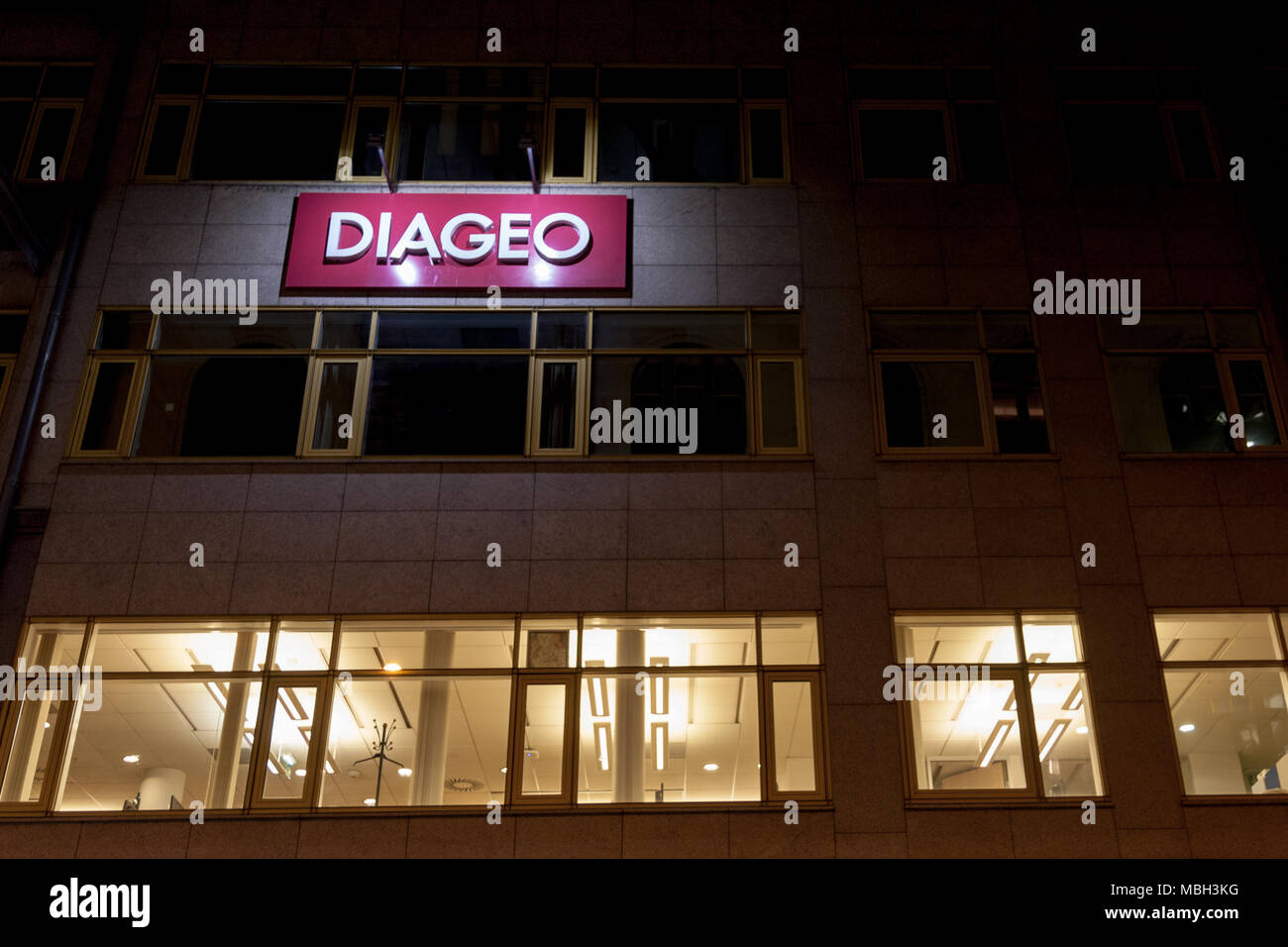 BUDAPEST, HUNGARY - APRIL 6, 2018: Diageo logo on their Budapest Main Office. Diageo is a British multinational alcoholic beverages company  Logo of D - Stock Image