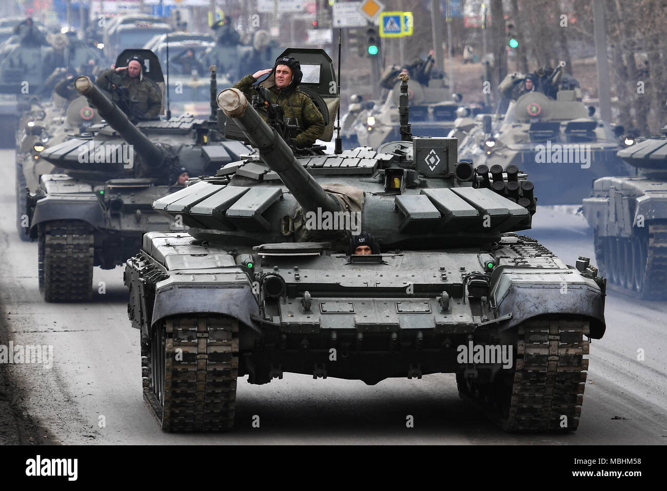Yekaterinburg, Russia. 11th Apr, 2018. YEKATERINBURG, RUSSIA - APRIL 11, 2018: Servicemen seen on T-72B3 battle tanks during a rehearsal of a Victory Day military parade commemorating the 73rd anniversary of the victory over Nazi Germany in the 1941/45 Great Patriotic War, the Eastern Front of World War II. Donat Sorokin/TASS Credit: ITAR-TASS News Agency/Alamy Live News - Stock Image