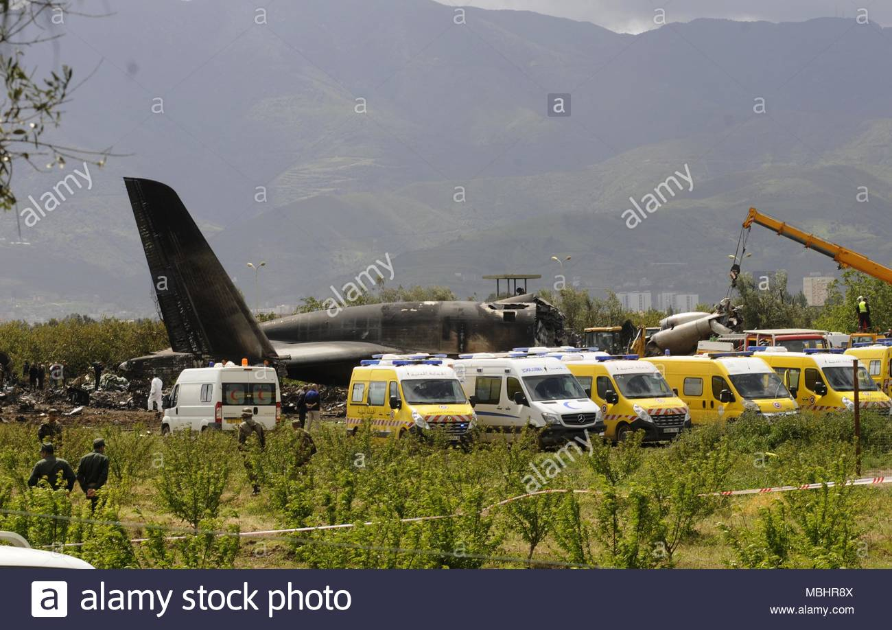 Boufarik, Algeria. 11th Apr, 2018. Rescuers and security forces deploy around the wreckage of an Algerian army plane which crashed near the Boufarik airbase from where the plane had taken off on April 11, 2018. The Algerian military plane crashed and caught fire killing 257 people, mostly army personnel and members of their families, officials said. (c) copyright Credit: CrowdSpark/Alamy Live News - Stock Image