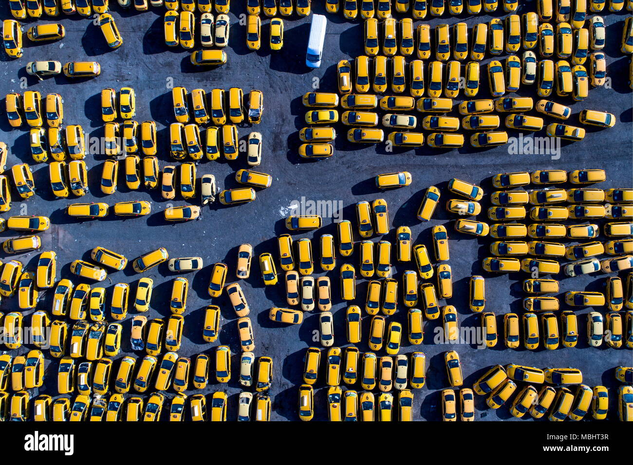 Moscow, Russia. 11th Apr, 2018. MOSCOW, RUSSIA - APRIL 11, 2018: An aerial view of a parking space for Yandex Taxi taxicabs. Some Russian taxi drivers have announced a nationwide boycott of mobility companies Gett, Uber and YandexTaxi over increased commission rates. Sergei Bobylev/TASS Credit: ITAR-TASS News Agency/Alamy Live News - Stock Image