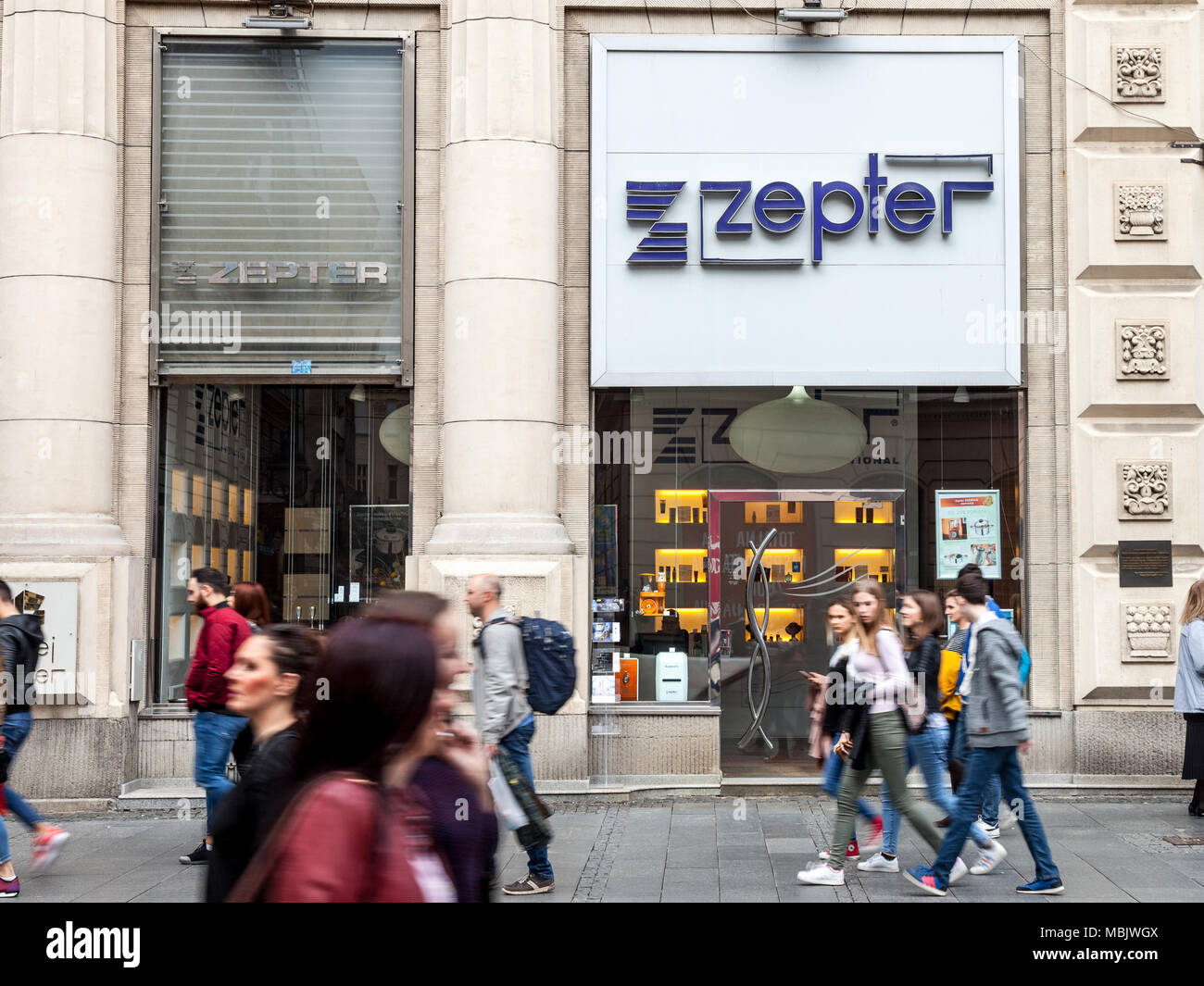 BELGRADE, SERBIA - MARCH 31, 2018: Entrance of a Zepter Shop with its logo and crowd pasisng in front. Founded by a Serb, Zepter International is a gl - Stock Image