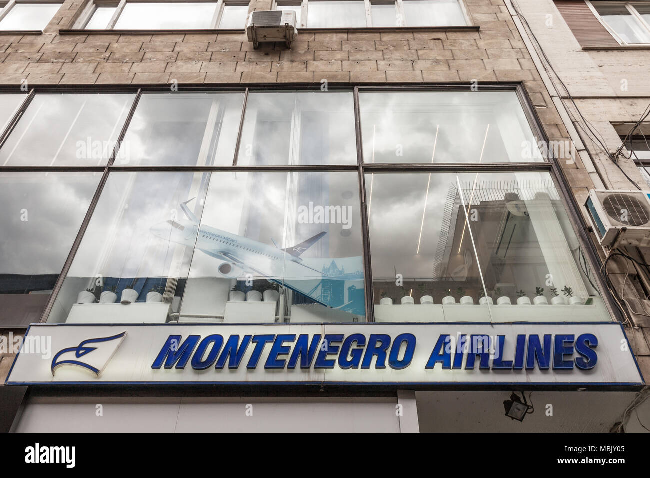 BELGRADE, SERBIA - MARCH 31, 2018: Montenegro Airlines logo on their main office for Serbia. Montenegro Airlines is the national air carrier of Monten - Stock Image