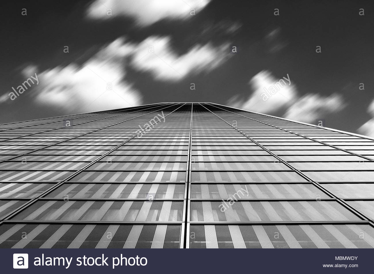 Modern architecture abstract with clouds in motion blur, dramatic minimalist black and white geometric picture - Stock Image