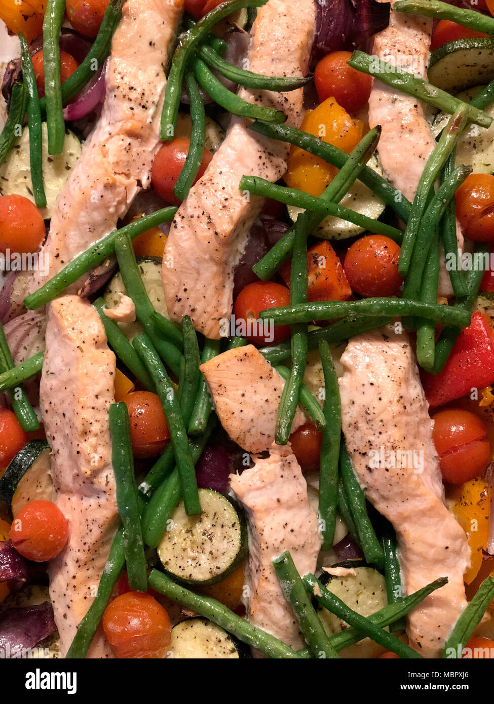 Freshly cooked salmon and vegetable bake - Stock Image