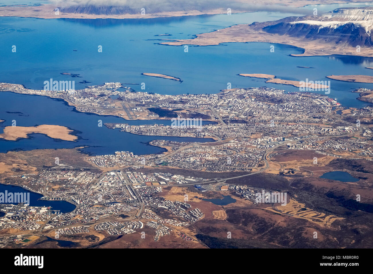 Aerial view of Reykjavik, Iceland, with the bay of Hofsvik and the Snaefellsness peninsula visible at the top Stock Photo