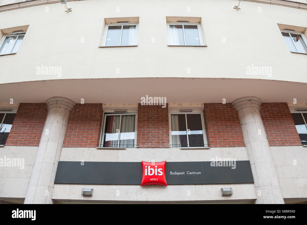 BUDAPEST, HUNGARY - APRIL 7, 2018: Ibis logo on their main hotel for Hungary during the afternoon Ibis is a hotel chain of the Accorhotel group  Pictu - Stock Image