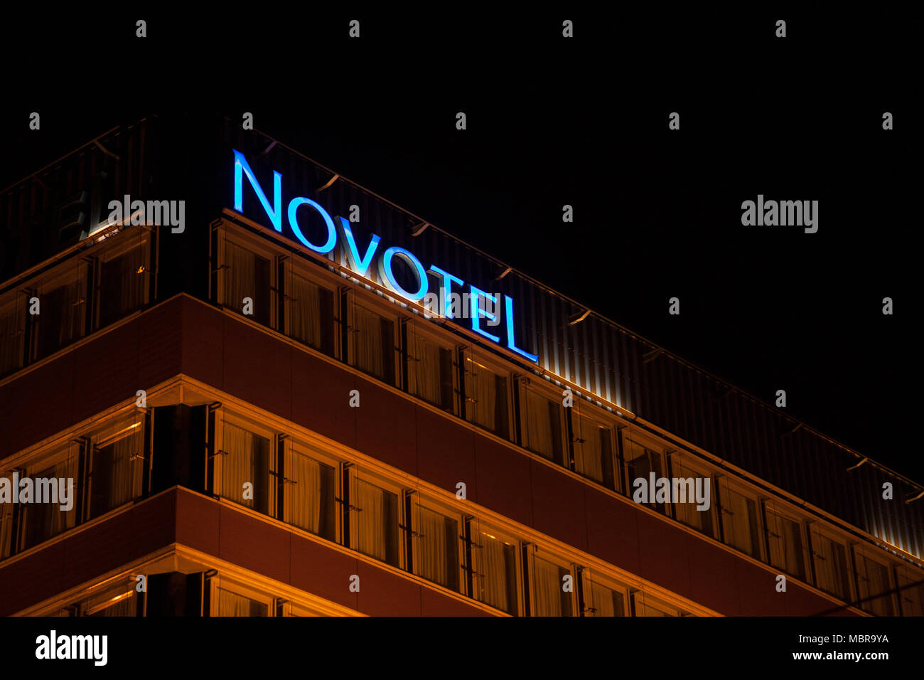BUDAPEST, HUNGARY - APRIL 7, 2018: Novotel logo on their main hotel for Hungary during the evening. Novotel is a hotel chain of the Accorhotel group   - Stock Image