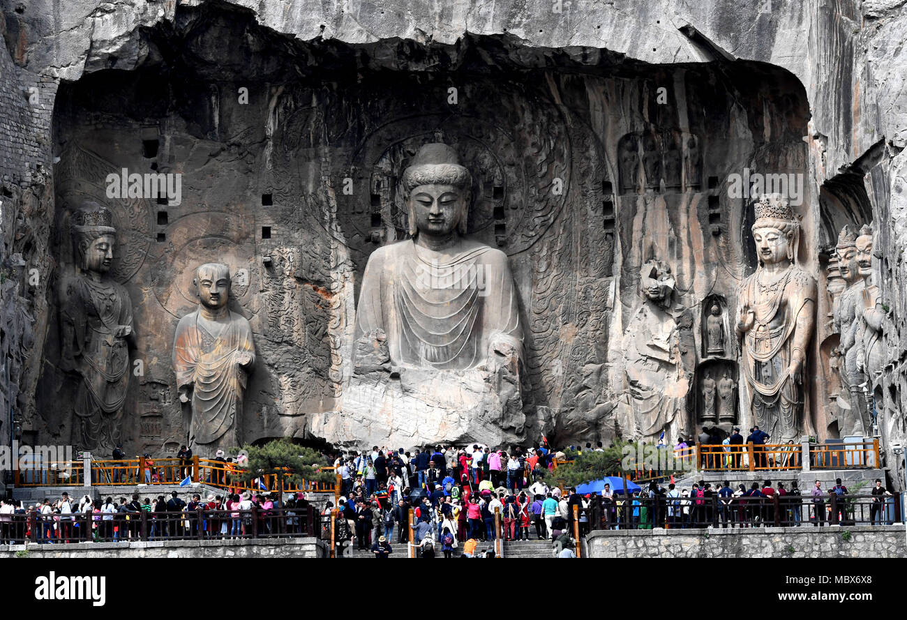 Zhengzhou, China's Henan Province. 11th Apr, 2018. People visit the Longmen Grottoes in Luoyang, central China's Henan Province, April 11, 2018. The Longmen Grottoes has started to greet its boom season for tourism since April. Credit: Zhu Xiang/Xinhua/Alamy Live News - Stock Image