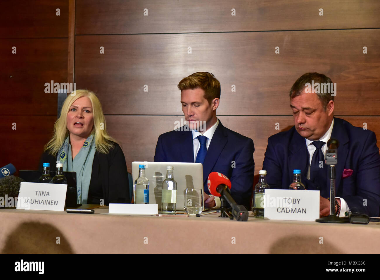 London, UK. 12 April 2018. 'Detained in Dubai' holds a press conference to discuss the status and update the public regarding the ongoing issues surrounding the escape and subsequent capture of Sheikha Latifa Al Maktoum, daughter of the ruler of the United Arab Emirates, Sheikh Mohammed bin Rashid Al Maktoum. Speakers include founder and CEO of Detained in Dubai, Radha Stirling, partner David Haigh and Toby Cadman of Guernica Chambers, alongside Tiina Jauhiaien and Hervé Jaubert. Pictured: Tiina Jauhiaien, David Haigh & Toby Cadman. Credit: Peter Manning/Alamy Live News - Stock Image