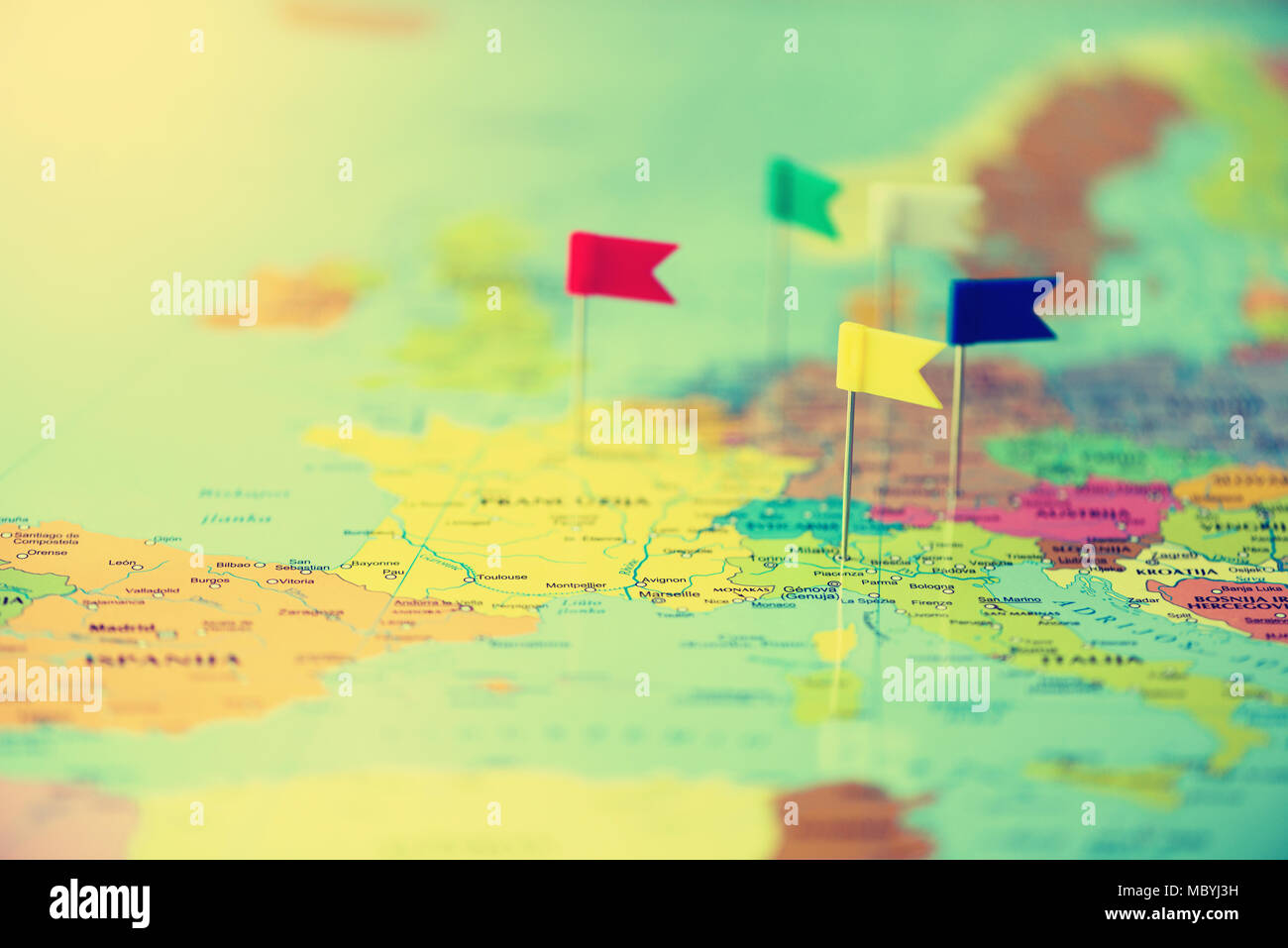 Colored flags, pushpins, thumbtack pinned on map of europe. Copy ...