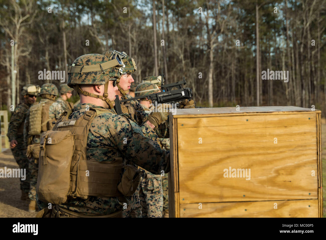 U.S. Marine Sgt. Sean A. O'Neill, center, a rifleman with Battalion Landing Team, 2nd Battalion, 6th Marine Regiment, 26th Marine Expeditionary Unit (MEU), prepares to fire an M320A1 40mm grenade launcher during a live-fire shooting range on Camp Lejeune, N.C., Jan. 16, 2018. The shooting range was held to increase the unit's proficiency and knowledge of 40-mm high-explosive grenade launching weaponry for the upcoming deployment of both Marines and Sailors. (U.S. Marine Corps photo by Lance Cpl. Tojyea G. Matally) - Stock Image
