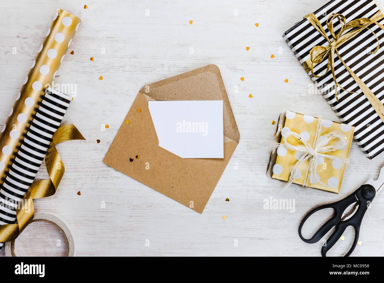 Blank greeting card in a craft envelope gift boxes and wrapping blank greeting card in a craft envelope gift boxes and wrapping materials on a white wood background m4hsunfo
