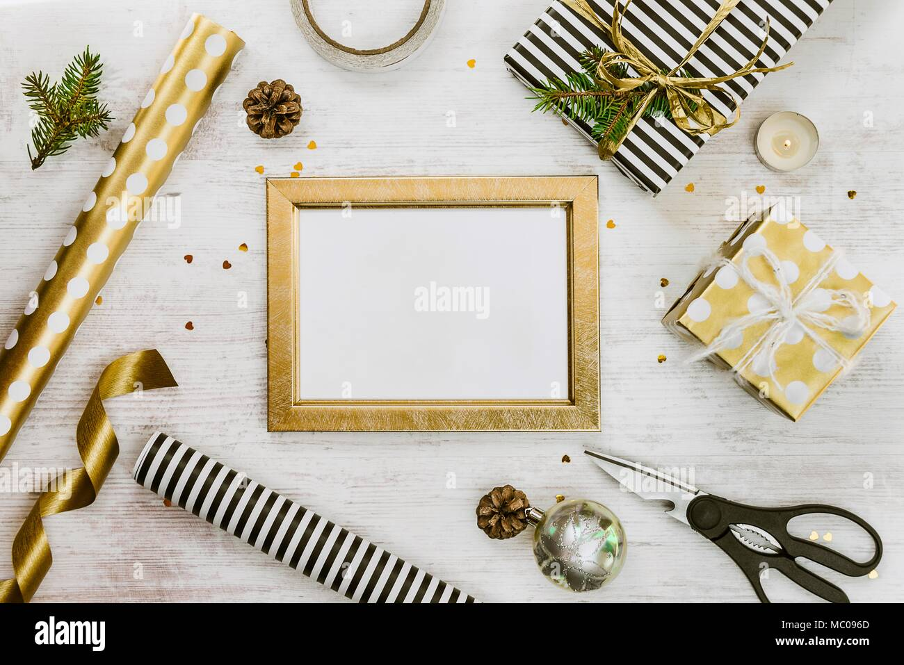 Golden ptoto frame, gift boxes, pine cones and christmas toys and ...