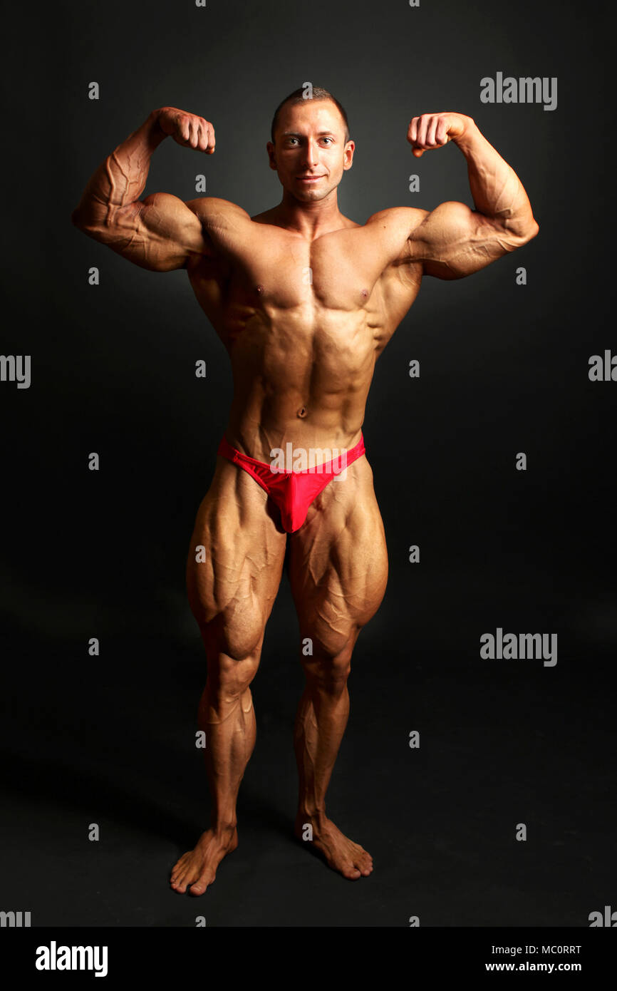 Male Bodybuilder Posing Showing Front Body Muscles Studio Shot On