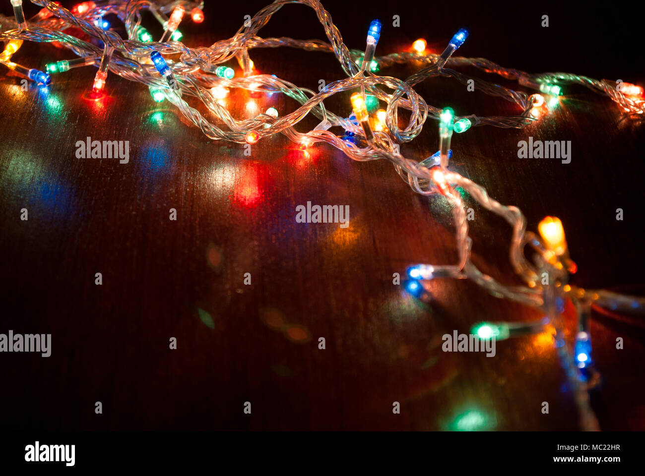 christmas colorful light on wooden desktop xmas and new year