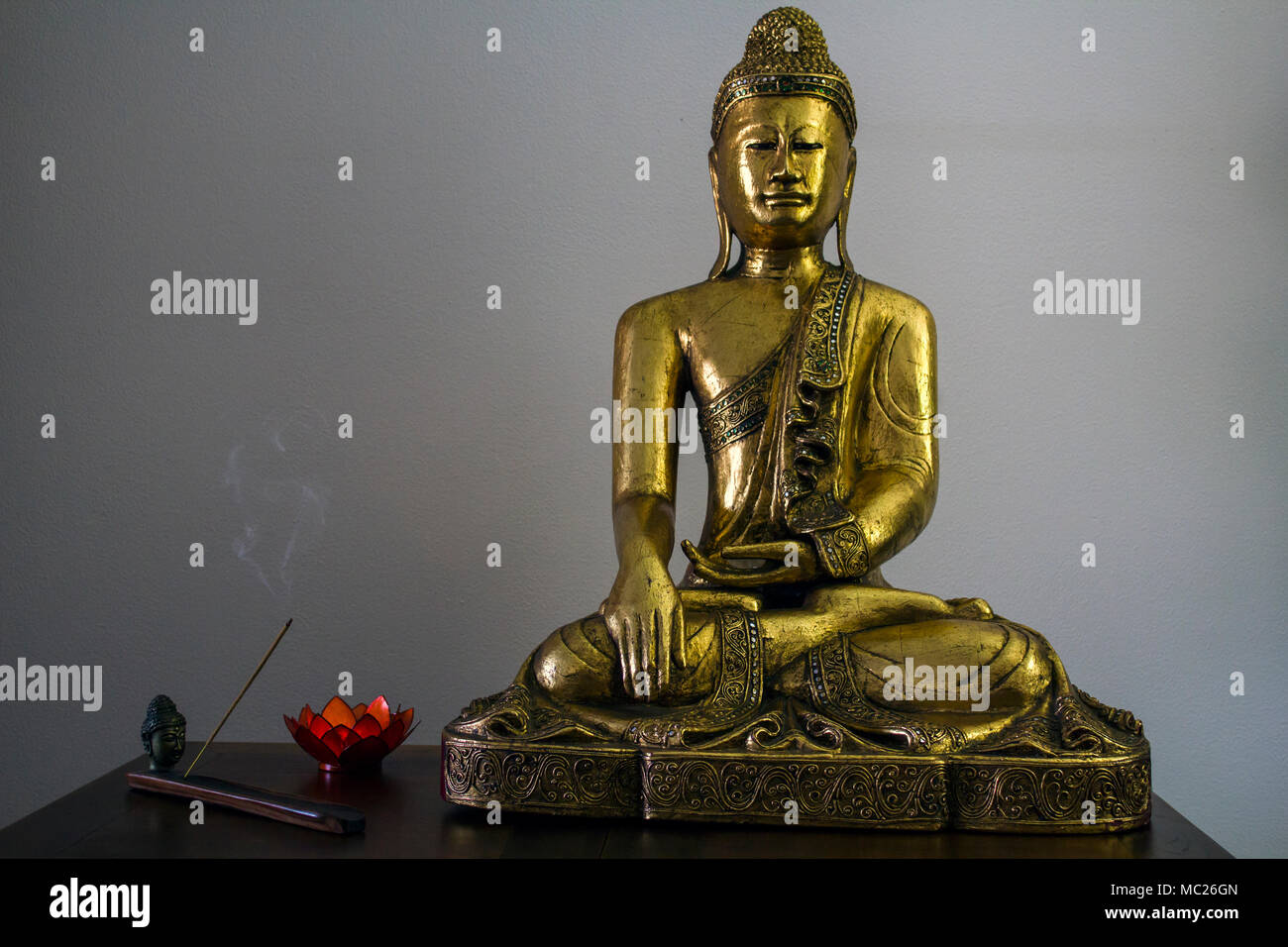 Big Buddha Statue And Incense Stick Burning In Incense Burner And