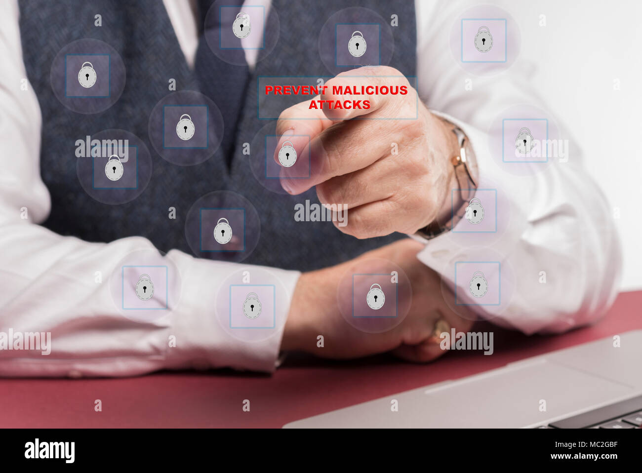 man sitting at touching prevent malicious attacks on a virtual screen. - Stock Image