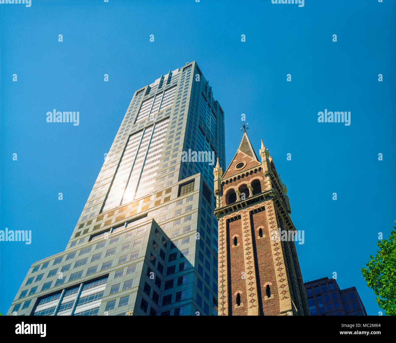 The spire of St Michael's Uniting Church, cnr Russell st and Collins street, in front of the 120 Collins st building, Melbourne, Victoria, Australia. - Stock Image