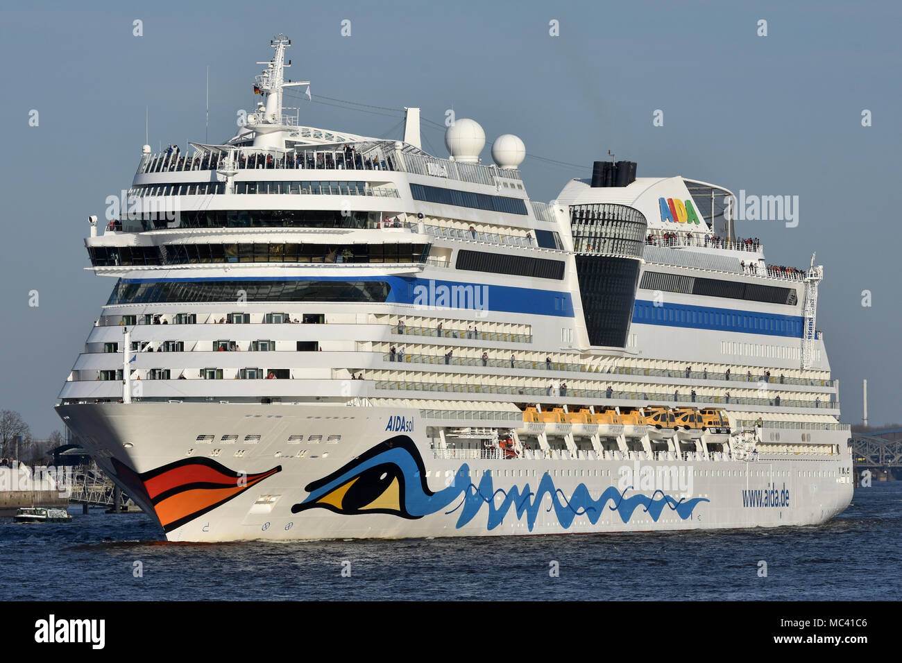 AIDAsol outbound from Hamburg cruise terminal - Stock Image