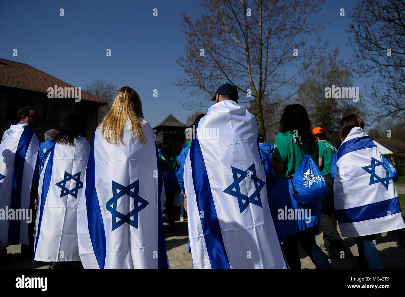 participants-carry-israeli-flags-at-the-former-nazi-german-auschwitz-birkenau-death-camp-during-the-march-of-the-living-at-oswiecim-the-annual-march-honours-holocaust-victims-at-the-former-nazi-german-auschwitz-birkenau-death-camp-in-southern-poland-MC42T9.jpg