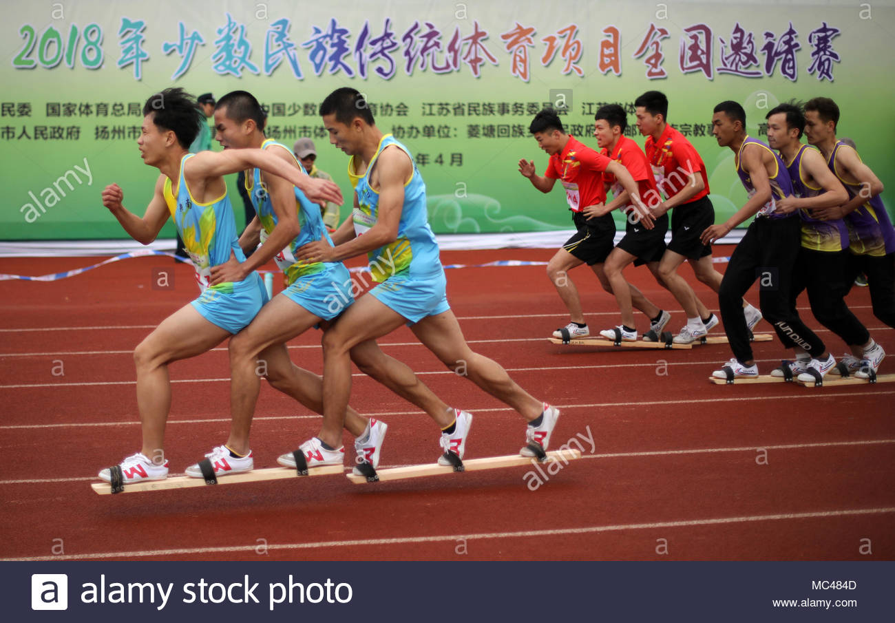 Gaoyou, China. 12th Apr, 2018. Ethnic minority traditional sports invitational tournament which include board-shoe racing and stilts racing held in Gaoyou, Jiangsu, China on 12 April 2018.(Photo by TPG/CNS) Credit: TopPhoto/Alamy Live News - Stock Image