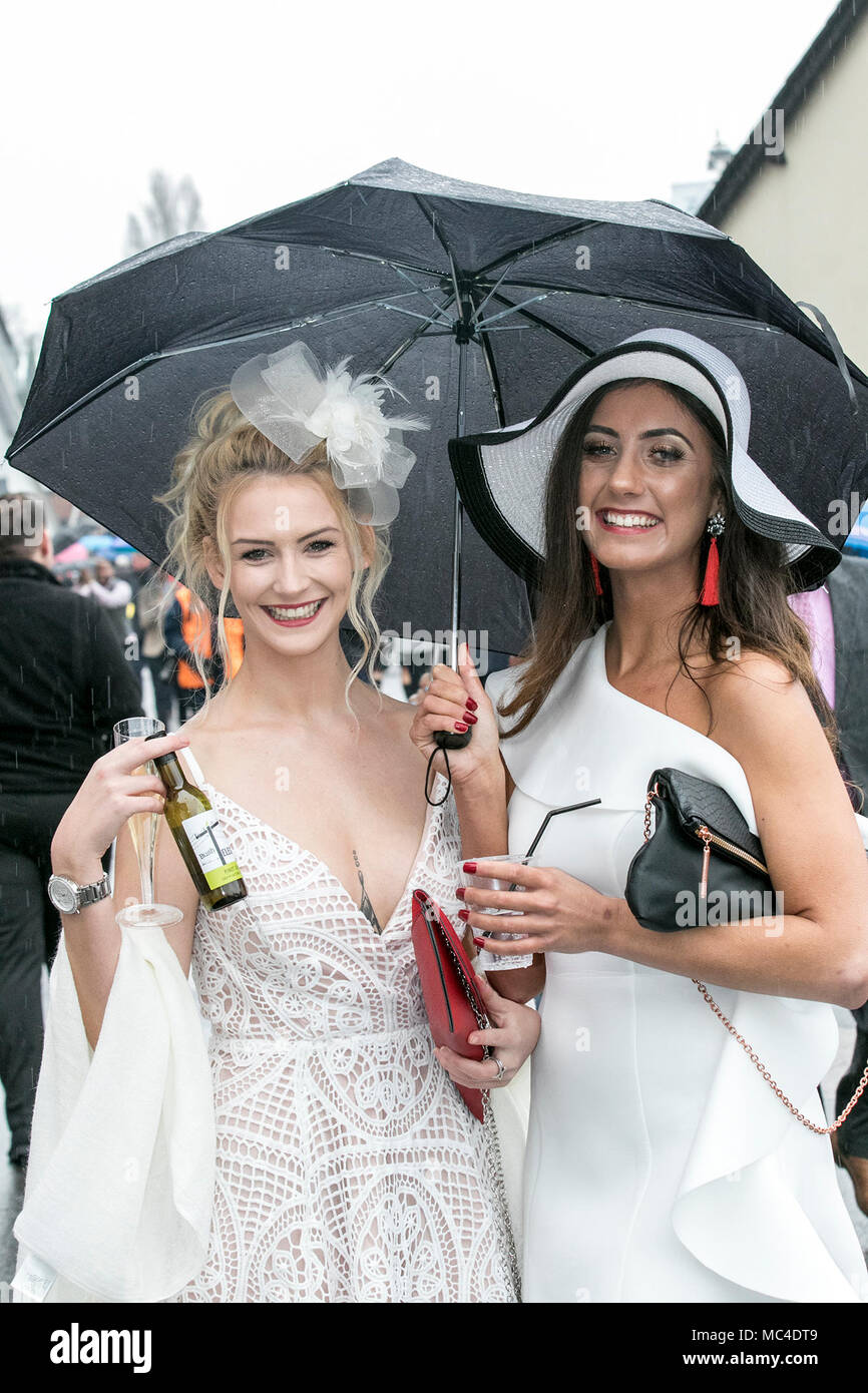 The Randox Health Grand National, Aintree, Liverpool, Merseyside. 13th April 2018.  The most famous event in the horse racing calendar welcomes people on this very special parade of Ladies outfits & the finest female fashions.  Racegoers have been urged to 'smarten up' to make the event more 'aspirational' as thousands of glamorous women pour through the entry gates on the one and only 'Grand National' as up to 90,000 visitors are expected to attend the spectacular National Hunt Racing event.   Credit: Mediaworld Images/Alamy Live News - Stock Image
