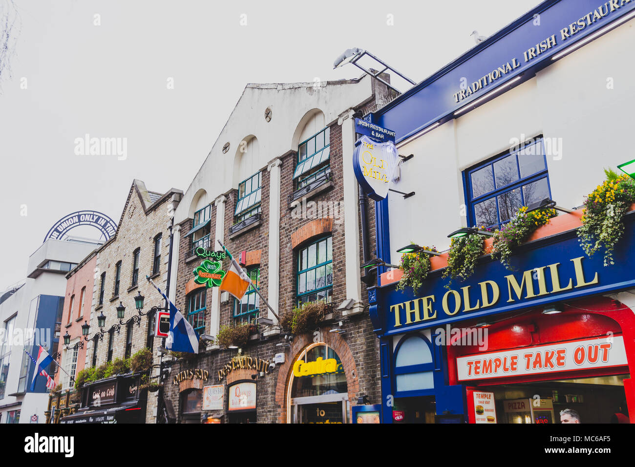 DUBLIN, IRELAND - April 12th, 2018: pubs in the Temple Bar neighbourhood of Dublin city centre, the area is famous for its popular traditional pubs an - Stock Image