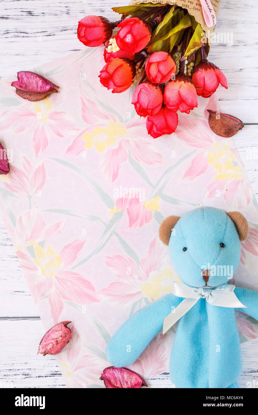 091d2051e00a9 Flat lay stock photography flower pattern message letter paper rose petals  blue bear doll