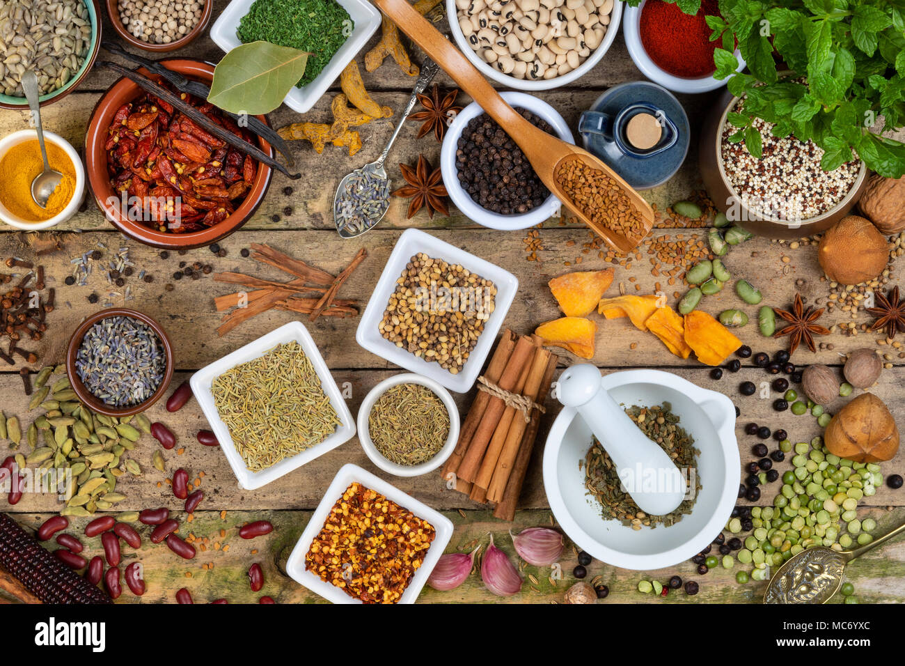 Selection of Herbs and Spices used in cooking to add flavor and seasoning. - Stock Image