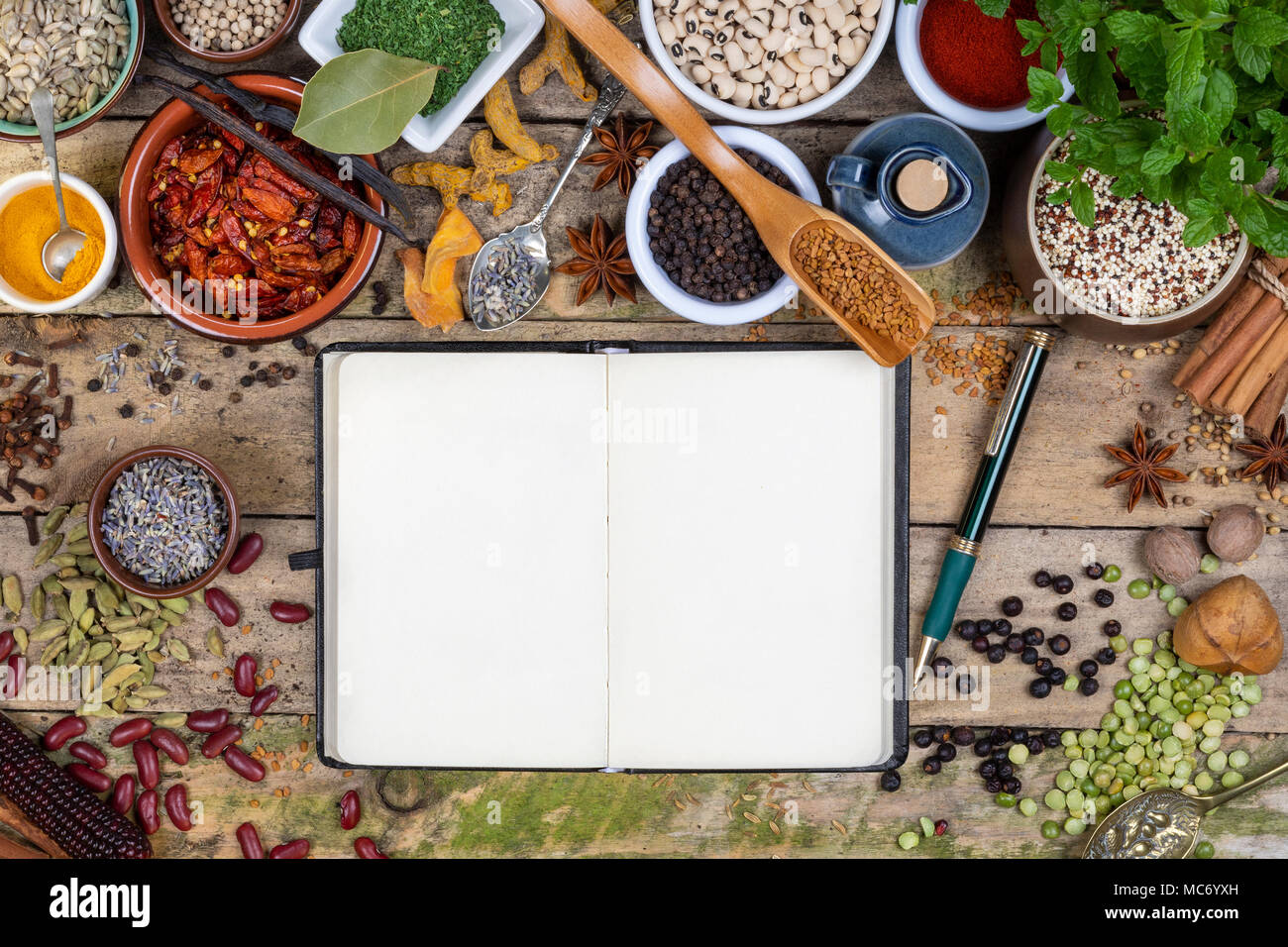 Selection of Herbs and Spices used in cooking to add flavor and seasoning - Space for text. - Stock Image