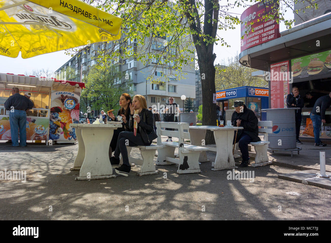 Yambol, Bulgaria. 13th Apr, 2018.Sunshine and icecreams  white blossom with blue sky light warm wind as a horse and cart travels along the street, market trader selling home grown goods. Credit: Clifford Norton/Alamy Live News - Stock Image