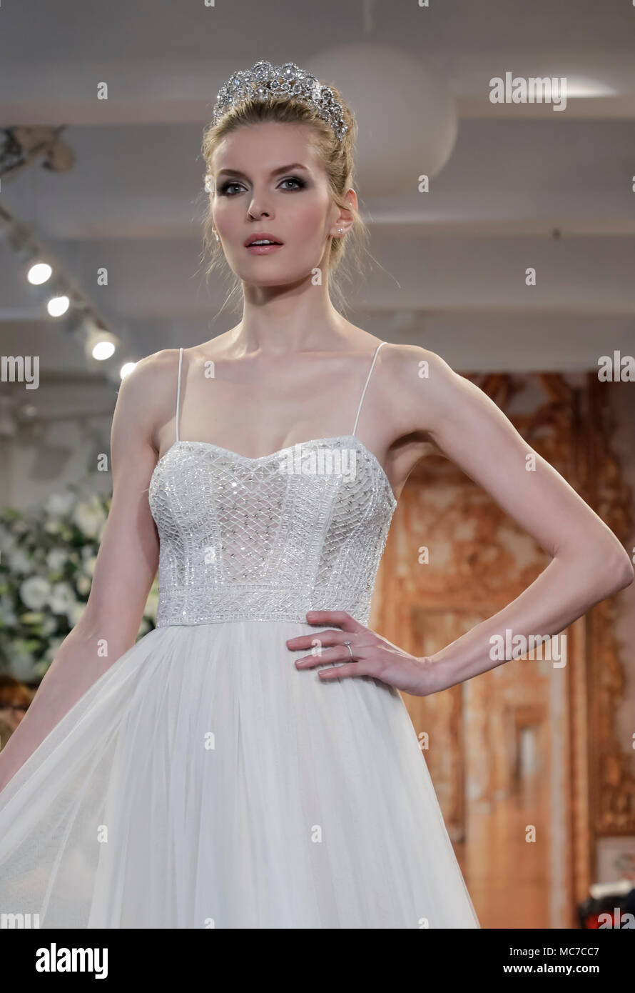 New York, USA. 12th Apr, 2018. A model walks the runway at the Theia runway show during New York Bridal Week at the Theia Showroom, Manhattan Credit: Sam Aronov/Alamy Live News - Stock Image