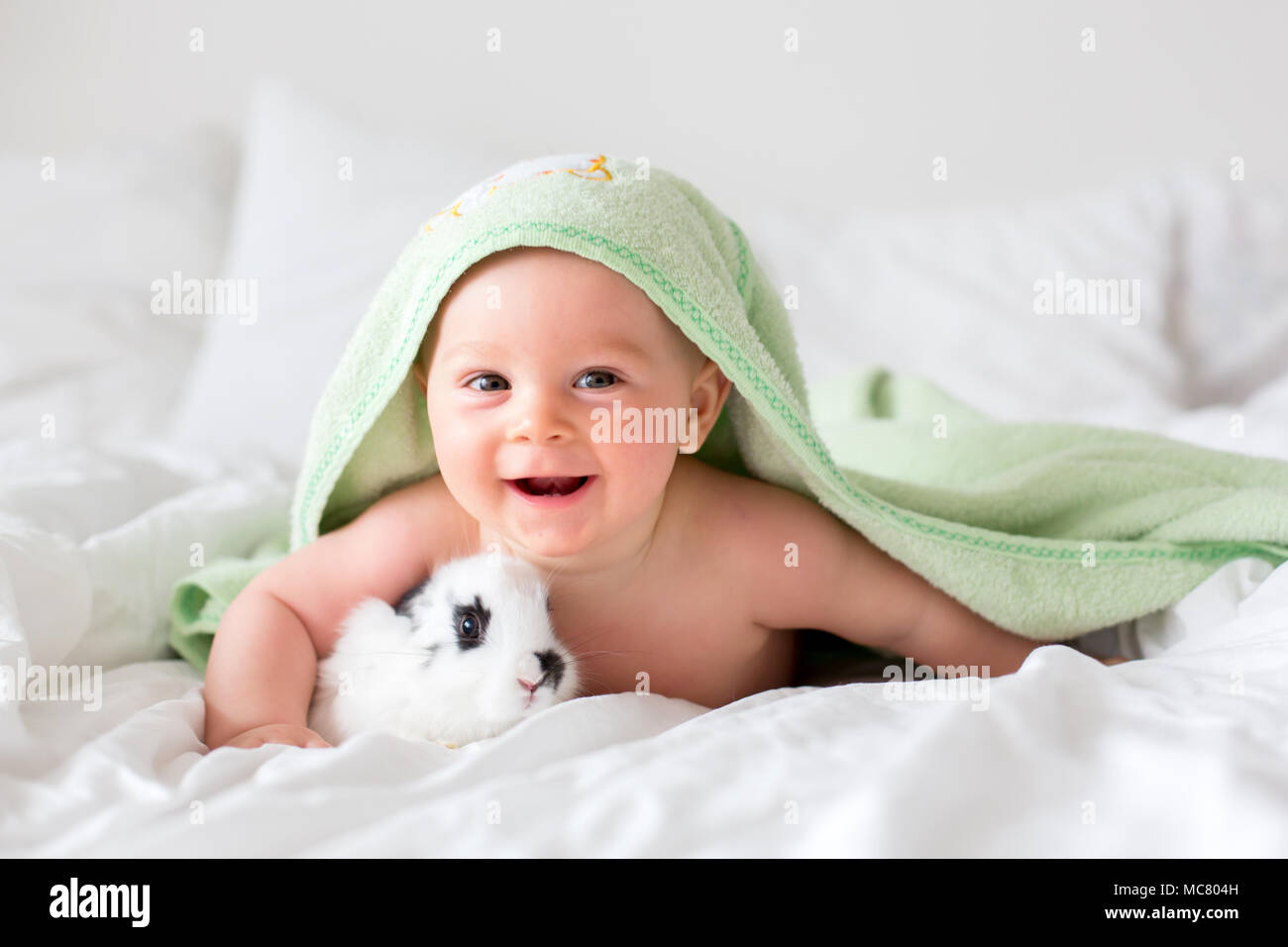 Cute Little Baby Boy With Little Rabbit In Bed After Bath Baby