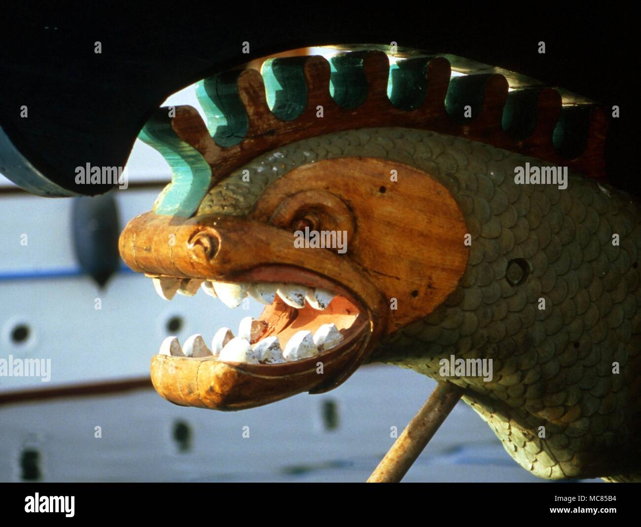 Dragon-like figure-head on the prow of a Spanish boat, intended to both guard the vessel, and repel evil forces. - Stock Image